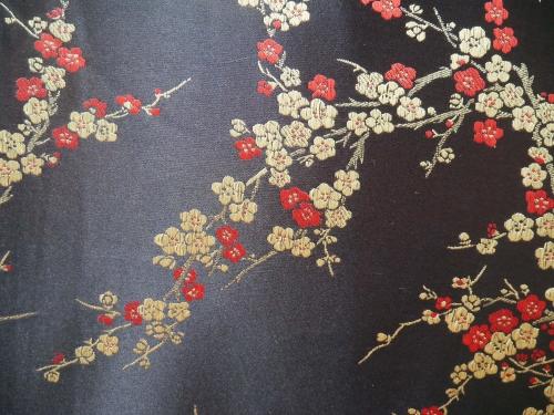Jaquardstoff Kirschblüte schwarz/gold/rot - Meterware