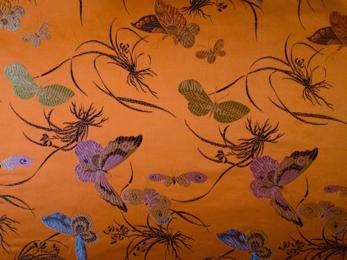 Jaquardstoff Schmetterlinge orange 115 cm breit - Meterware
