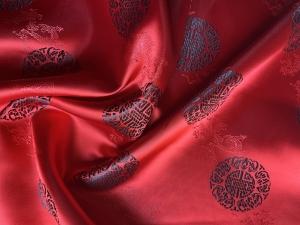 Jaquardstoff rot mit schwarzen Glückszeichen - Meterware